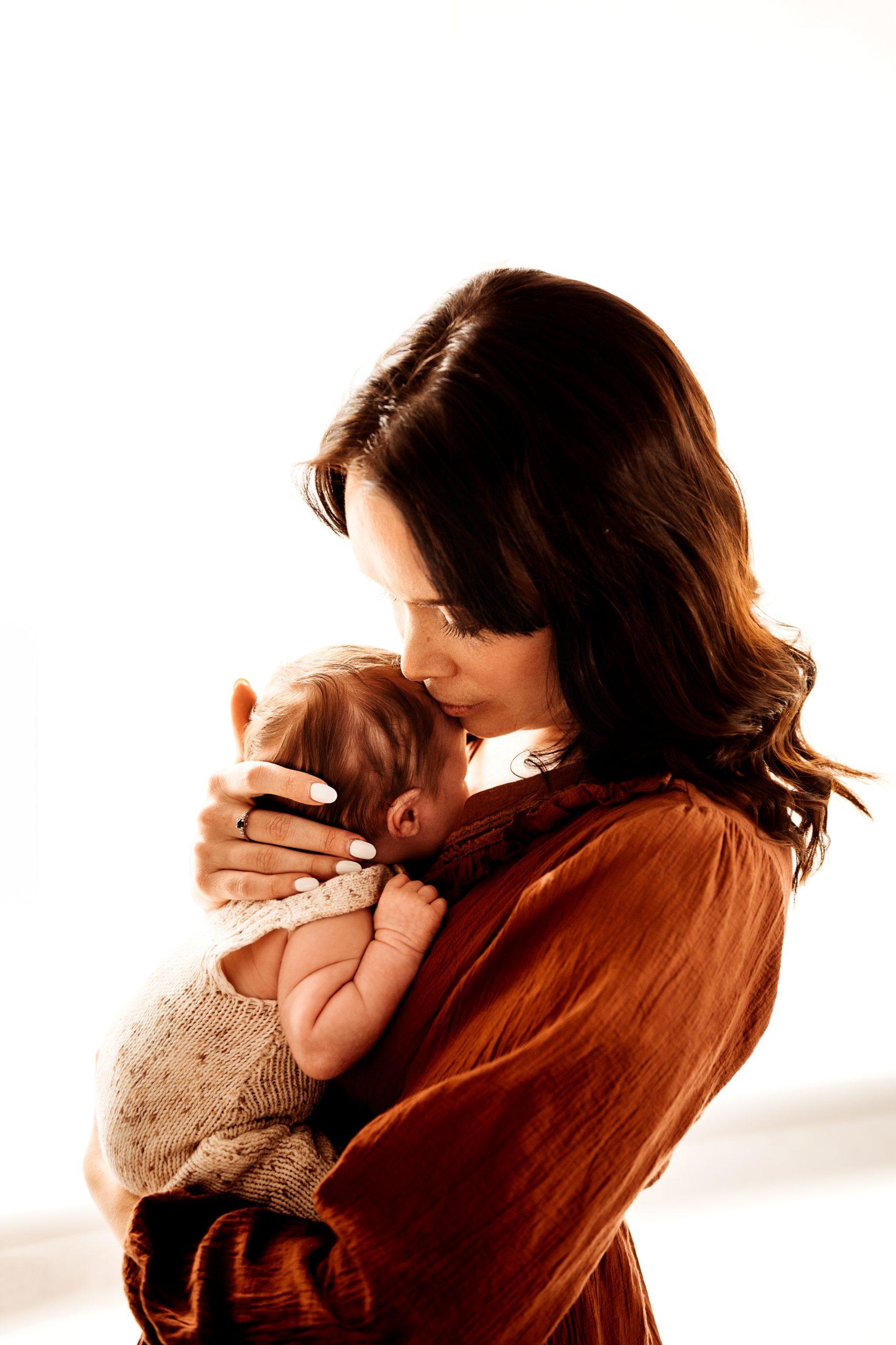 canberra newborn photographer expecting mum and dad cuddling